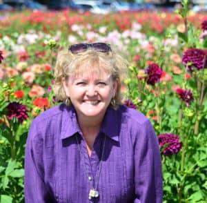 Traveling with Purpose - Nancy Hann among the Dahlia's