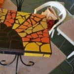 Mosaic table grouted with brown grout
